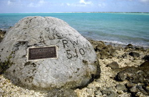 "A memorial to prisoners of war is seen Jan. 12 on Wake Island. The ""98 Rock"" is a memorial for the 98 U.S. civilian contract POWs who were forced by their Japanese captors to rebuild the airstrip as slave labor, then blind-folded and killed by machine gun Oct. 5, 1943. An unidentified prisoner escaped, and chiseled ""98 US PW 5-10-43"" on a large coral rock near their mass grave, on Wilkes Island at the edge of the lagoon. The prisoner was recaptured and beheaded by the Japanese admiral, who was later convicted and executed for war crimes. (U.S. Air Force photo/Tech. Sgt. Shane A. Cuomo)"